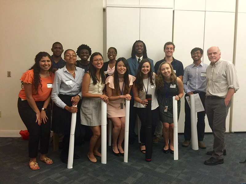 2016 NIAMS summer interns pose with Dr. John O'Shea following NIH Summer Poster Day.