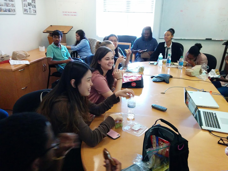 NIAMS trainees share a laugh during a brown bag lunch seminar.