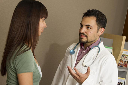 A male doctor talking with a woman patient